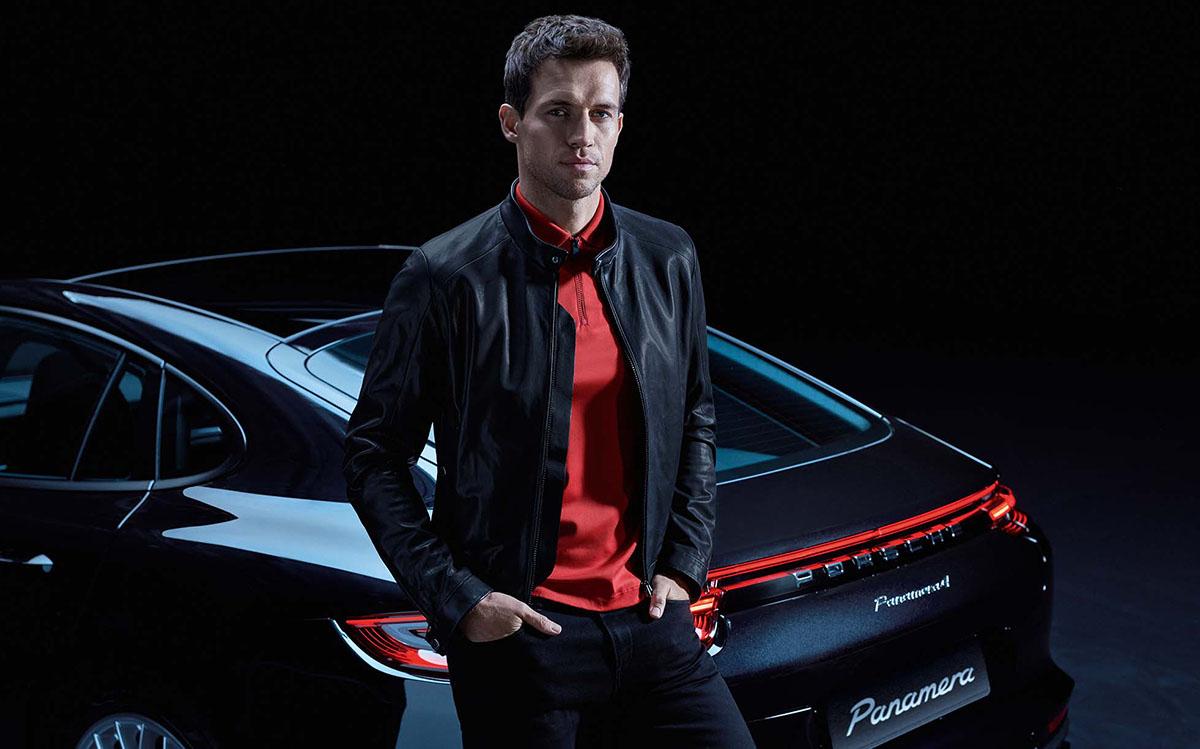 Hugo Boss model next to Porsche car