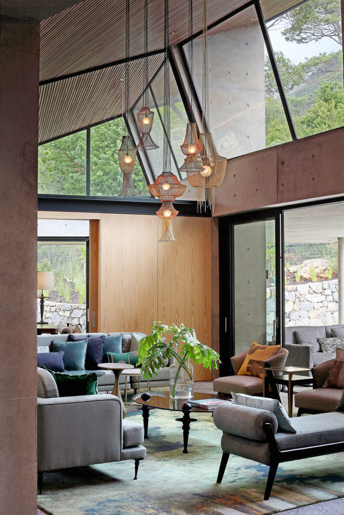 Designer finishes interacts with nature through double volume window design